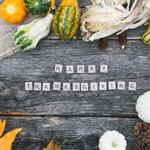Happy Thanksgiving table with gourds surrounding