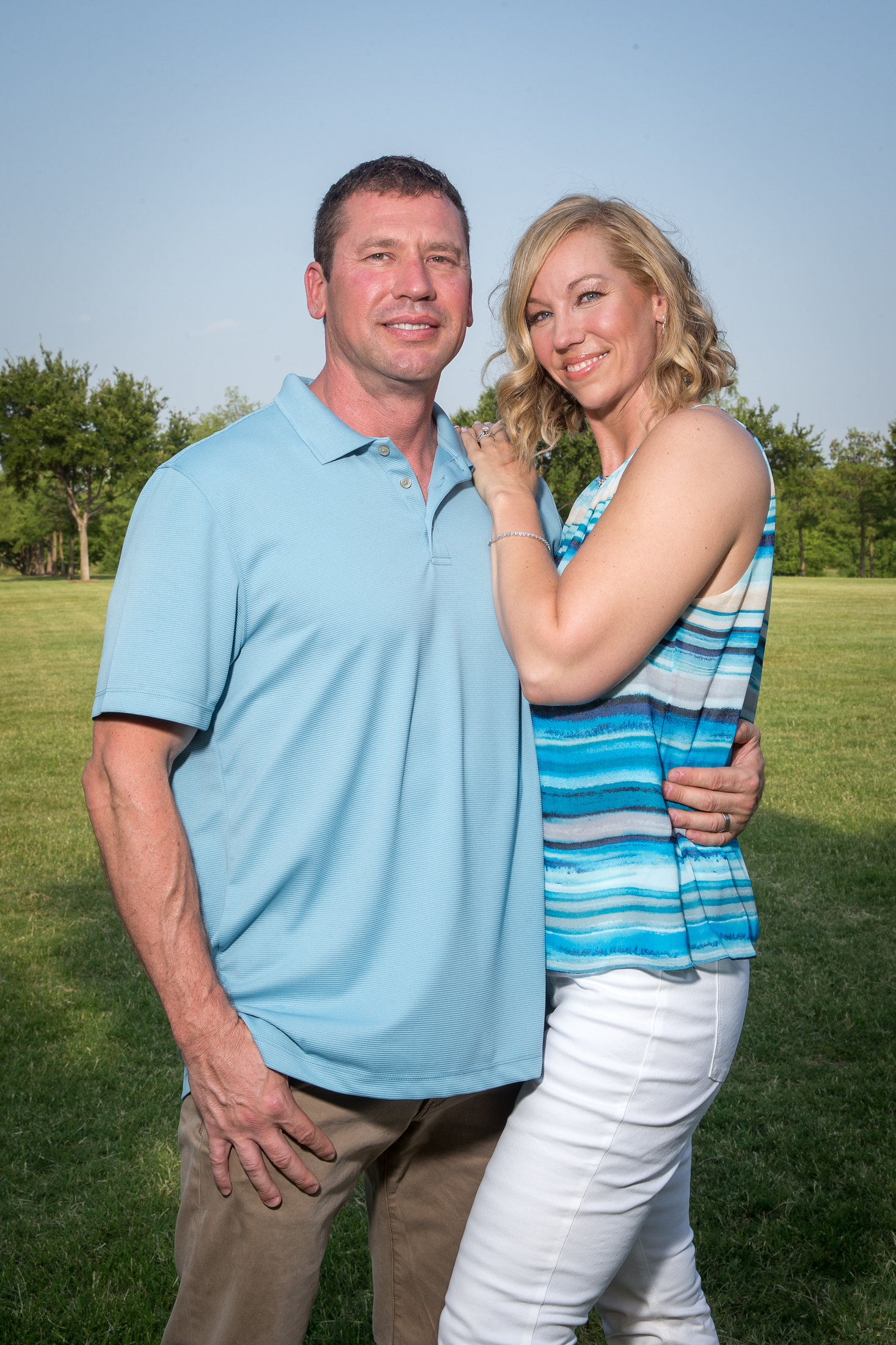 Jeff and Heidi standing together happily at the park